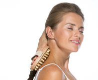 Young woman using massager on neck Stock Image