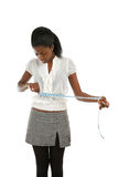 Young woman using measuring tape Stock Image