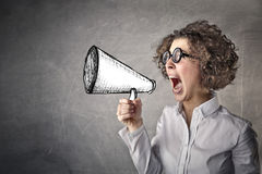 Young woman using a megaphone Royalty Free Stock Photo
