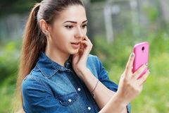 Young woman using mobile. Beautiful happy smiling young woman using mobile Royalty Free Stock Photography