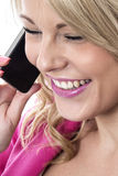 Young Woman Using a Mobile Cell Phone Royalty Free Stock Photo