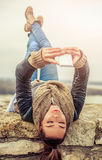 Young woman using mobile on the fortress Royalty Free Stock Photos
