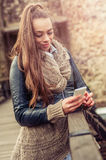 Young woman using mobile on the fortress Royalty Free Stock Image