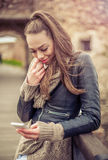 Young woman using mobile on the fortress Stock Photography