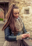 Young woman using mobile on the fortress Stock Photos