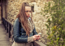 Young woman using mobile on the fortress Royalty Free Stock Images