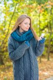 Young woman using a mobile outdoors in autumn Royalty Free Stock Images
