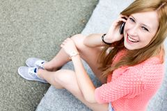 Young woman using mobile phone Stock Photo