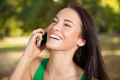 Young woman using mobile phone Royalty Free Stock Photography
