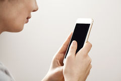 Young woman using mobile phone Stock Photography