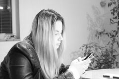 Young Woman Using Mobile Phone Stock Images
