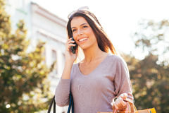 Young woman using a mobile phone Royalty Free Stock Images