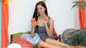 Young Woman using Mobile Phone in a colorful interior enjoying a vacation. Full HD. Young Tourist Woman holding smartphone in in a colorful interior texting stock video footage