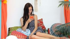Young Woman using Mobile Phone in a colorful interior enjoying a vacation. Full HD. Young Tourist Woman holding smartphone in in a colorful interior texting stock video