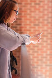 Young woman using mobile phone in corridor Royalty Free Stock Image