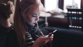 Young woman using the mobile phone, emailing while sitting in the café. Being a blogger. Modern lifestyle. Online. Young woman using the mobile phone stock video footage