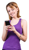 Young woman using mobile phone Royalty Free Stock Images