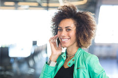 Young woman using mobile phone in office Stock Photography