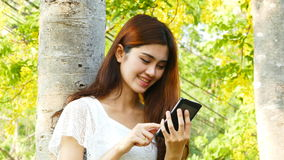 Young woman using mobile phone. stock video
