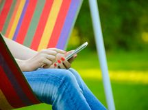 Young Woman Using Mobile Smart Phone Outdoors Royalty Free Stock Image