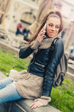 Young woman using mobile on the street Stock Images