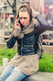 Young woman using mobile on the street Royalty Free Stock Photos