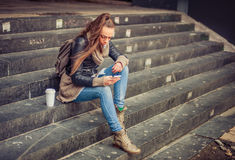 Young woman using mobile on the street Royalty Free Stock Photography