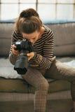 Young woman using modern dslr photo camera Royalty Free Stock Image