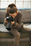 Young woman using modern dslr photo camera Royalty Free Stock Images