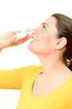 Young woman using nasal spray Royalty Free Stock Photography