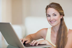Young woman using a notebook Royalty Free Stock Image