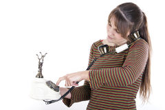Young woman using an old phone Royalty Free Stock Images