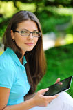 Young woman using pc tablet outdoors Royalty Free Stock Image