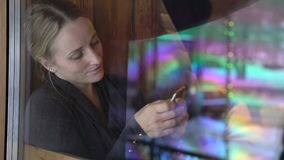 Young woman using phone in a cafe stock video footage