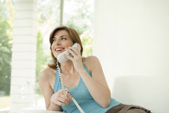 Young Woman Using the Phone at Home Stock Photos