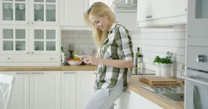 Young woman using phone at home stock video