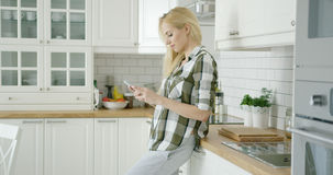Young woman using phone at home Royalty Free Stock Photography