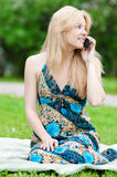 Young woman using phone at park Royalty Free Stock Photos