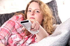 Young woman is using a remote control Stock Photo
