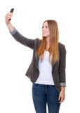 Young woman using smart phone Royalty Free Stock Images