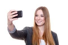 Young woman using smart phone Stock Images