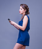 Young woman using smart phone. Royalty Free Stock Photo