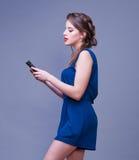 Young woman using smart phone. Beautiful young woman using smart phone Royalty Free Stock Photo