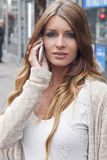 Young Woman Using Smart Phone. On the street Royalty Free Stock Image