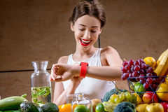 Young woman using smart watch in the kitchen Stock Image
