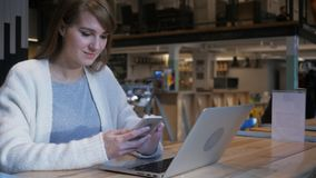 Young Woman Using Smartphone in Cafe, Typing SMS stock photos