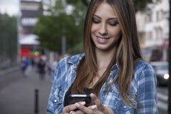 Young woman using a smartphone Stock Photography