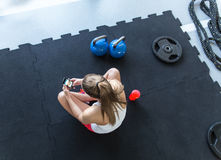Young woman using smartphone at the gym Stock Images