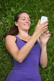 Young woman using a smartphone Royalty Free Stock Images