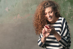 Young woman using smartphone Stock Photos